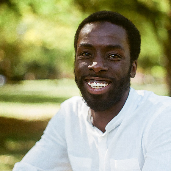 a photograph of Desmond Cole outside on a sunny summer day